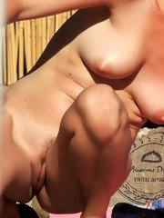 Her sexy body gets a tan after she strips naked